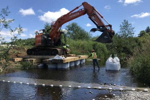 Excavator works on restoration project
