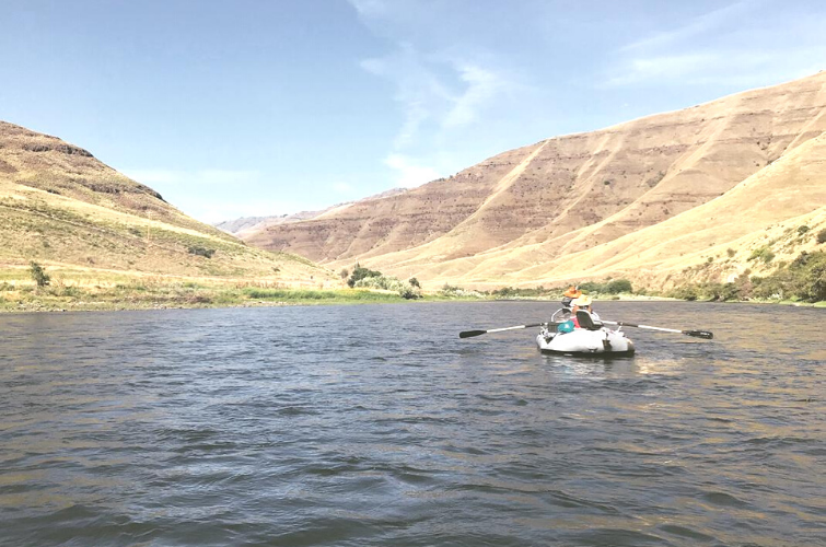 People in paddle boat on Grande Ronde River.