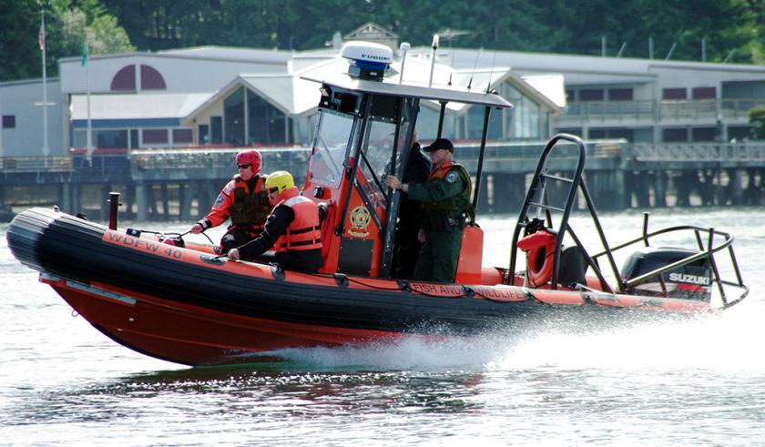 WDFW Enforcement Personnel on Speed Boat