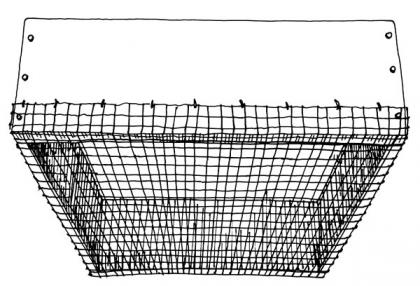 A drawing shows chicken wire covering the bottom of a garden planter.