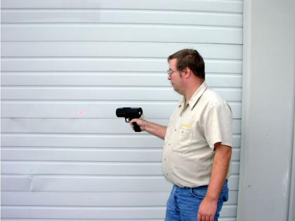 Man shooting laser on to wall