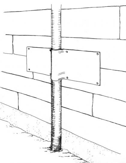 A drawing depicts flashing wrapped around a drainpie to prevent climbing.