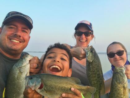 family fishing for bass, all smiles