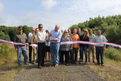 Group cutting a ribbon