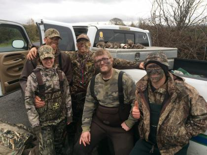 Group of hunters after successful duck hunt