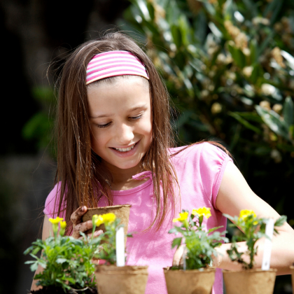 Girl prepares plants for garden