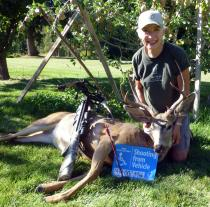 Special User Permit hunter with deer she harvested