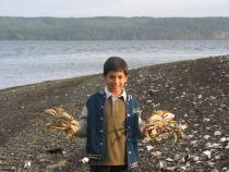 Boy with two Dungeness Crabs at Hood Canal
